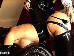 Fetish Pictures -  FetishNetwork.com - Mistress Carmen oversees the degradation of her latex slave pigs