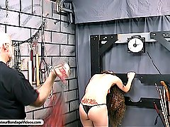 Fetish Pictures -  FetishNetwork.com - Master Len breaks out the whip against tied up Nicole