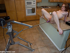 BDSM Toys Pictures -  hot red head machine fucked in her own kitchen - cums like mad!