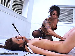 Asian Pictures -  Candles from over head drip onto Mistress Toki is slave in this Japanese Bondage film.  This slave has been especially naughty and Mistress Toki does not tolerate naughty slaves.  She places a stick in her slave is mouth and whips her ass until it turns a
