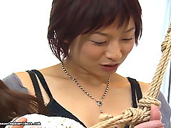 Asian Pictures -  Sweet June wanted to know what being tied up felt like.  She enlisted her twisted friend Masa and asked her tie her up.  Masa obliged and tied her hands behind her back and her leg and hands to the rope hanging from the ceiling.  Masa then took June is he