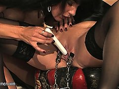 Extreme Pictures -  Mistress Carmen lashes out at her trembling slaves