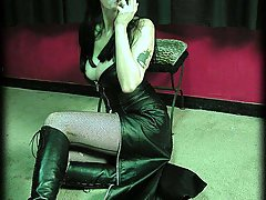 Fetish Pictures -  Sexy goth slut Katja lights her cigar and plays with the smoke