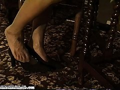 Fetish Pictures -  A lovely brunette lets her shoes slip from her feet and hang from her toes