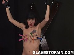 Pain Pictures -  Sexy Tina is chained and gets het pussy and tender tits abused