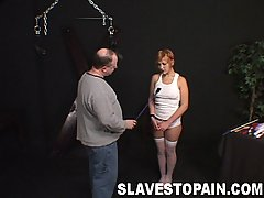 Slaves Pictures -  Carmen gets a hard spanking and tit pinching for the amusement of her master