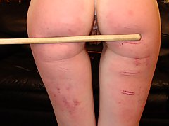 Spanking Pictures -  Slutty Cheerleaders get their asses paddled by the punishment officer