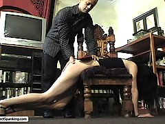 Spanking Pictures -  Captive whores are spanked and caned and humiliated with the enema bag