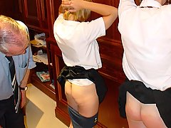 Spanking Pictures -  The Punishment Officer seeks to teach two brats with his leather strap
