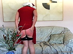 Spanking Pictures -  Santas Elves have a little fun with their paddles