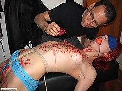 Bondage Pictures -  Simone gets her tender tits savagely cut by rope and twine