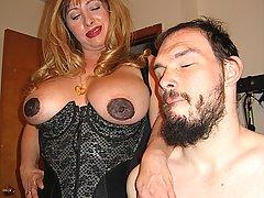 Bondage Pictures -  Buxom Mistress Cristian dominates and humiliates her bizarre man slave