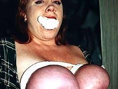 Bondage Pictures -  Huge boobed Rusty gets her giant melons abused