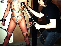Bondage Pictures -  Sexy Slave Ann is bound in heavy chains and hung from hooks