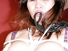 Bondage Pictures -  Asian whore is panty gagged and terrified by Ricks extreme bondage