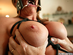 Mature Pictures -  Hot MILF cunt is gagged, tied up, and pounded!