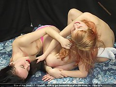Wrestling Pictures -  Topless women in breast-biting catfight