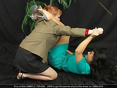 Wrestling Pictures -  Two violent businesswomen wrestle to the floor