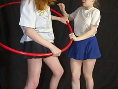Wrestling Pictures -  Women try hula-hoop with bad results