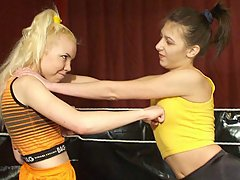 Wrestling Pictures -  Hot boob-punching teen wrestling session