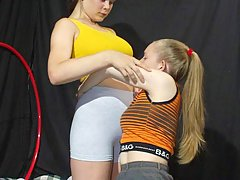 Wrestling Pictures -  Busty girl overpowers her opponent