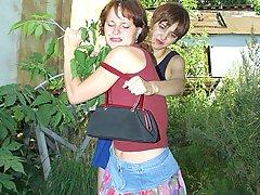 Wrestling Pictures -  Women in catfight in garden