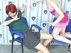 Wrestling Pictures -  Blonde kicks and punches redhead's face