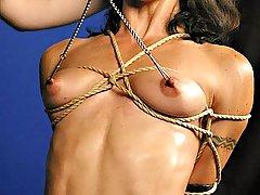 Amateurs Pictures -  Mistress Bridgett torments Wenona\'s nipples and juicy pussy