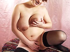 Pregnant Pictures -  Sweet faced pregnant model unleashes her huge pregnant belly and play with her big tits