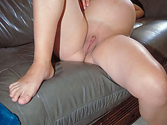 Pregnant Pictures -  Big bellied hottie cuddling her wet pussy