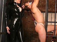 BDSM Pictures -  Chained stud gets a nasty whipping and spanking from a chick