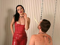 BDSM Pictures -  Naughty domina beats and waxes a stud