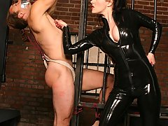 BDSM Pictures -  Mistress Anastasia Pierce disciplines her bound slave by dripping hot wax across his back