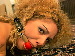 Punishment Pictures -  Kiki bound and gagged, helpless on the floor.