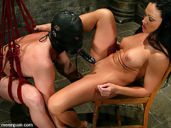 Femdom Pictures -  Mistress Cherokee slaps and knees her slave into submission
