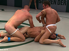 Gay Pictures -  Four naked fighters fight in front of a screaming audience.