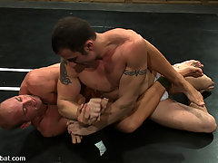 Gay Pictures -  Patrick Rouge and Spencer Reed are going all out, fighting and fucking on Naked Kombat.