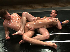 Gay Pictures -  Ripped Shane Erickson fights Kyle Sparks naked in oil.