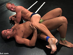 Gay Pictures -  Hot muscular studs fight with hard cocks in oil.