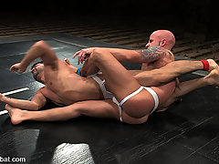 Gay Pictures -  Two ripped studs fight and fuck hard!