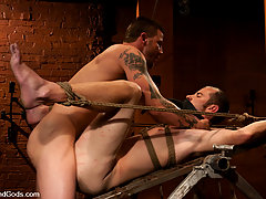 Gay Pictures -  Brenn Wyson gives Nomad the hardest bondage fuck on Bound Gods.