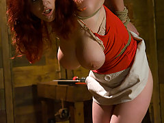 Submission Pictures -  Busty redhead in bondage sucking cock and fucked.