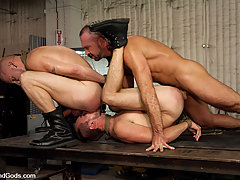 Gay Pictures -  Josh West ties up and fucks Luke Riley and Kain Warn in the metal shop.