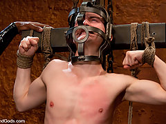 Gay Pictures -  Studly Scott Alexander fucks CJ in bondage and cums all over his face.