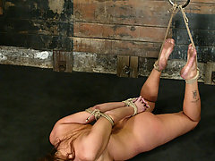 Bondage Pictures -  Huge boobed Christina Carter is bound and forced to cum.