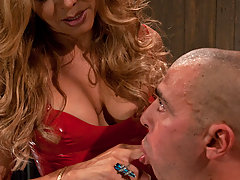 Transgender Pictures -  TS Johanna B in a long bright red latex dress is worshiped by her boy toy. He sucks her cock, rims her ass, licks her tits and gets pounded in his as