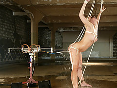 Water Bondage Pictures -  German blond bombshell gets tied up, hosed down and fucked.