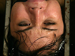 Water Bondage Pictures -  Petite brunette is bound and abused in an underground dungeon
