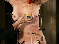 Water Bondage Pictures -  Long legged redhead is whipped, fucked and sprayed with water