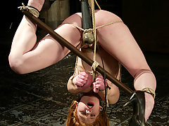 Bondage Pictures -  Hot redhead gets sprayed, dunked and vibed
